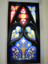An original stained glass window now located in the guest accomodation kitchen.