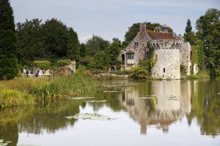 Visitors at Scotney Castle, Kent. Scotney Castle is a country house, romantic garden and 14th century moated castle - all set in a beautiful wooded estate ©National Trust Images.