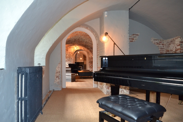 Arches appear everywhere within the Finchcocks Piano Schools Music Cellar. Image copyright Rachael Hale
