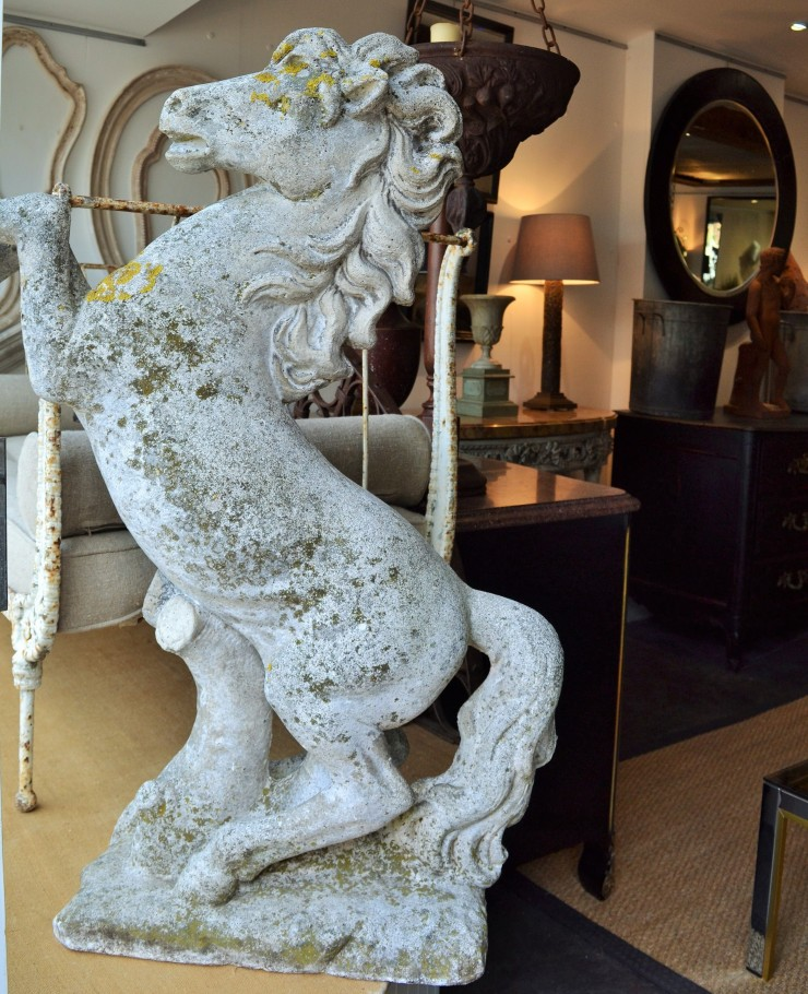 An imposing antique garden horse ornament on sale at Marchand Antiques. Image copyright Rachael Hale