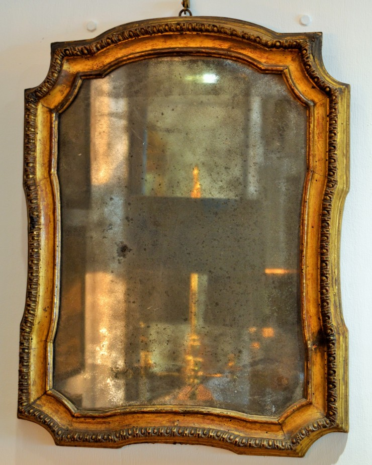 An atmospheric 18th century mirror on display at Marchand Antiques. Image copyright Rachael Hale